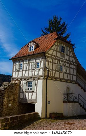 Residential tudor style house , with blue sky in background. Castle Neuenb rg in Germany.