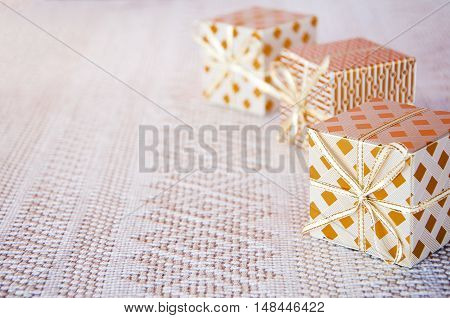 Holiday festive fashionable packings packages box of purchases on a white wooden background