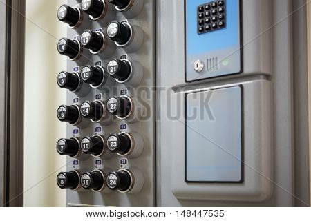 Block of buttons with numbers in the elevator cabin.