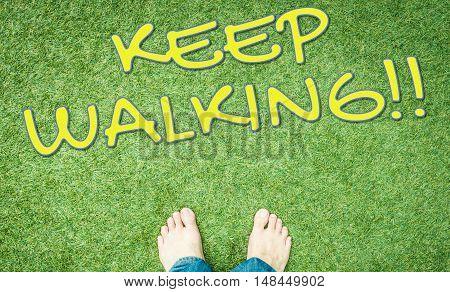 Bare feet on green grass keep walking