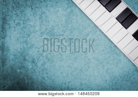 Music keyboard on blur grungy cement background