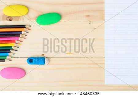 School and office supplies on wooden background, back to school