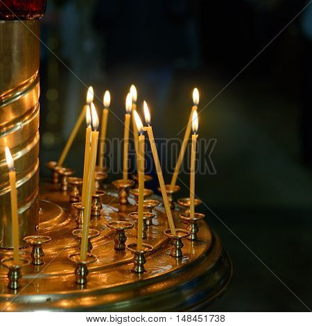 burning wax candles in the Christian church