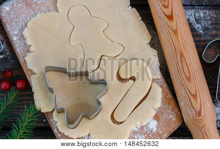 Baking Christmas Cookies - Dough On A Board With Flour, Cookie Cutters And Cookies. New Year. Christ