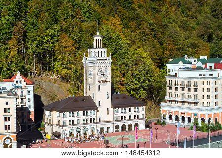 SOCHI RUSSIA - OCTOBER 31 2015: Rosa Khutor Clock tower and infrastructure of Alpine ski resort. Constructed from 2003 to 2011. Krasnaya Polyana Sochi Krasnodarskiy kray Russia