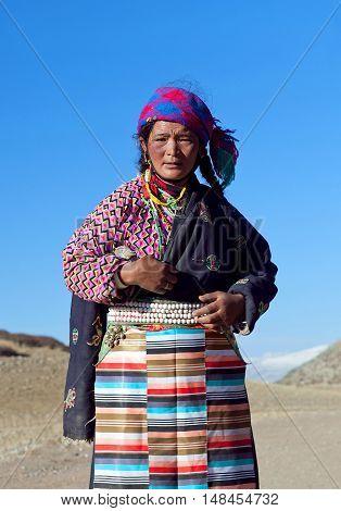 NGARI PREFECTURE, TIBET - MAY 7, 2013: Tibetan woman on the trail around sacred mount Kailash in Ngari Prefecture, Tibet Autonomus Region of China.