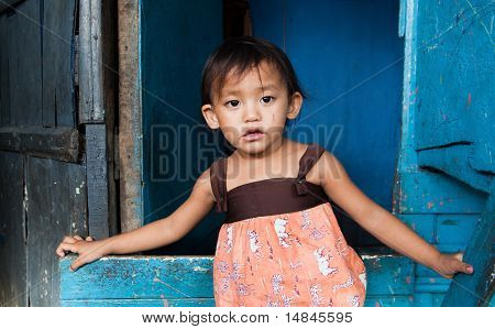 Young Girl Living In Poverty