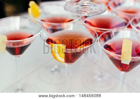 Glasses with Martini garnished with a slice of orange. Beautifully arranged, catering, actual shooting not Studio