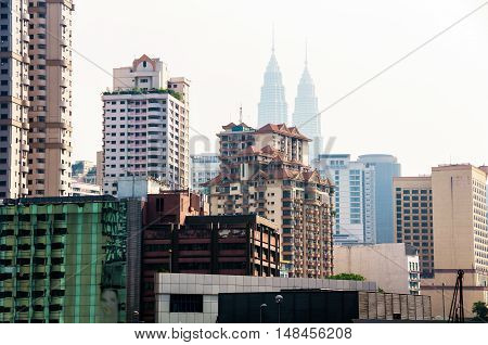 Cityscape of the famous city Kuala Lumpur in Asia. Impressive skyline with various skyscrapers. Roof pools and green parks