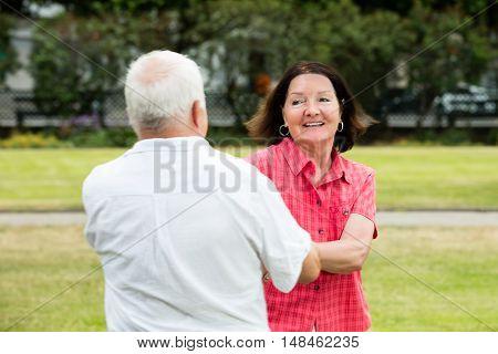 Smiling Senior Couple Having Fun In Park