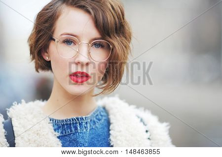 Happy Intelligent Smiling Girl In Glasses Outdoors