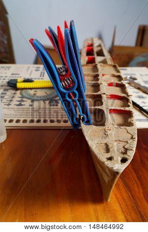 unfinished cardboard trunk for warship model on the workshop