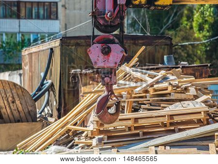 The crane is on a construction site. Hook closeup.