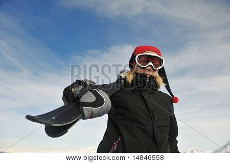 happy young woman have fan while relaxing at snow with ski and snowboard sport at winter seasonyoung healthy woman skiing on fresh snow at winter season in france alps