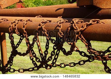 Old rusty iron piles and iron chains