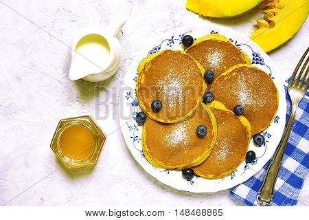 Pumpkin Pancakes With Fresh Blueberry And Honey.top View.