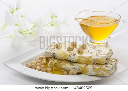 Eastern sweets. In the background .Nuga poured honey. jar with honey.