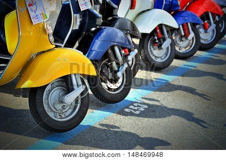 Genova, Liguria, Italy - September 18, 2016: Oktoberfest in Victory Square in Genoa, the first edition of motorsport meeting HBier rally dedicated to Vespas, Lambrettas and Fiat 500.