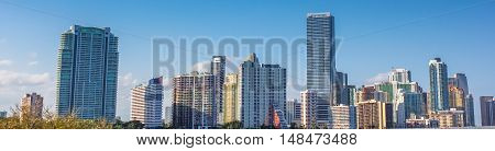 Panorama of Miami skyscrapers and skyline. Miami South Beach in Downtown District in sunny day. Apartment and business buildings in Miami Beach, Florida.
