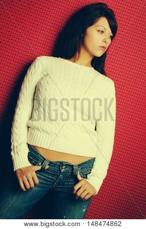 Pretty young woman wearing jeans