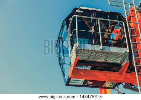 Cockpit of modern crane industry detail. Blue sky background