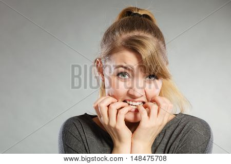 Nervous Girl Biting Nails.