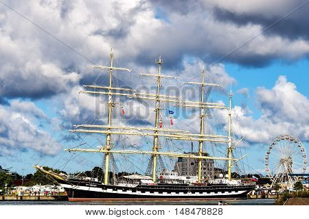 Rostock, Germany - August 22, 2016: Kruzenshtern or Krusenstern is a four-masted barque. Hansesail in Warnemuende and Rostock harbor.