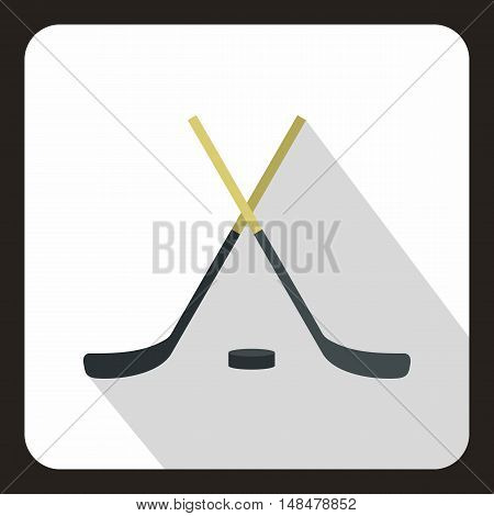 Hockey sticks and puck icon in flat style with long shadow. Sport symbol vector illustration
