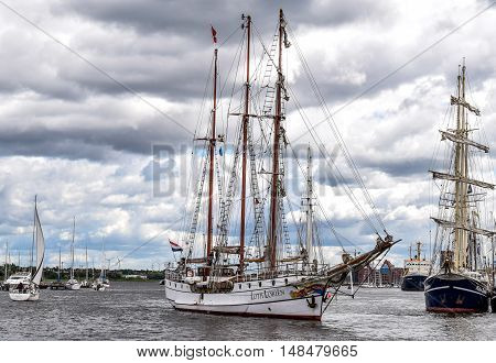 ROSTOCK, GERMANY - AUGUST 2016: three-masted barque Loth Lorien. Hansesail in Warnemuende and Rostock harbor with lots of sailing ship from all over the world.