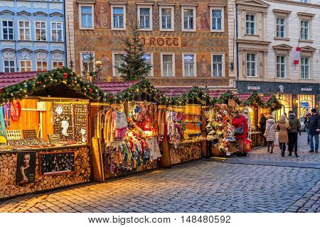 PRAGUE, CZECH REPUBLIC - DECEMBER 10, 2015: Wooden booths offering souvenirs during Christmas market taking place each year on December. It is very popular destination with tourists visiting Prague.