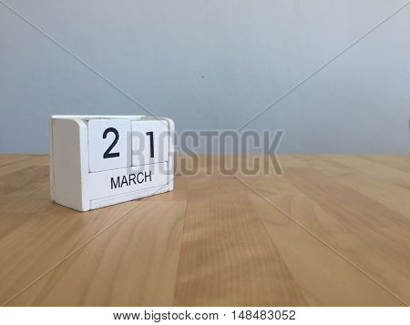 March 21St. March 21 White Wooden Calendar On Vintage Wood Abstract Background. First Spring Day.cop