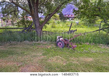Photo of old agricultural machine on a green grass