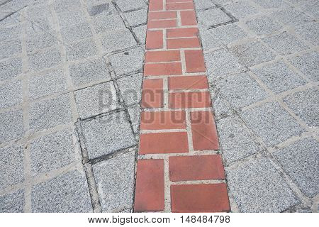 straight brick walkway to reach the destination