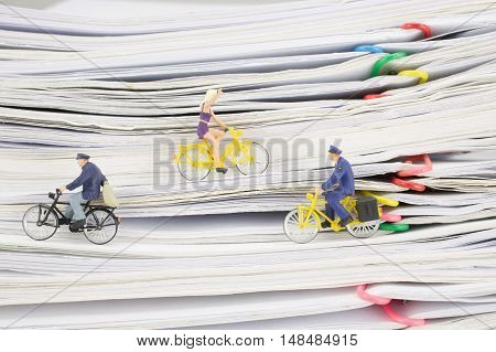 Close Up Postmen And Woman Cycling On Pile Overload Paperwork