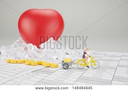 Woman Cycling And Carry Yellow Pill With Blur Heart