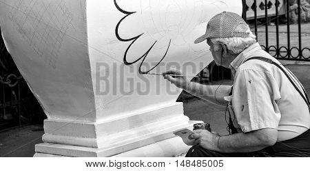 Tallinn, Estonia, 10.09.2016. Painter decorator at work