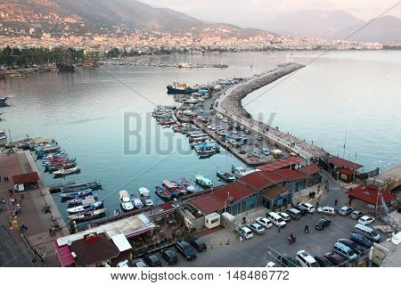 Autumn view of the old harbor and the lighthouse in Alanya. Turkey.