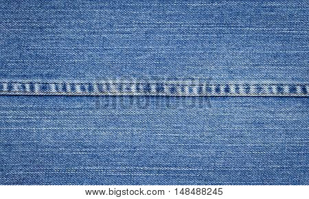 Closeup of denim jeans texture with seams.You can apply for jean background, jean backdrop, jean wallpaper and everything about denim and jean background for you design