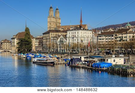 Zurich, Switzerland - 2 December, 2015: view along the Limmat river and the Limmatquai quay. Zurich is the largest city in Switzerland and the capital of the canton of Zurich.