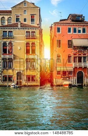 Gondolas or boats on Grand canal in beautiful town Venice with sunset