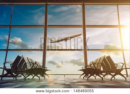 Airplane view from airport terminal . backlit scene .