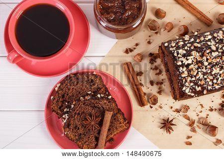 Dark Cake With Chocolate, Cocoa And Plum Jam, Cup Of Coffee, Delicious Dessert