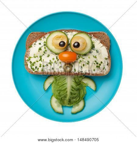 Funny cat made of bread and vegetables on plate
