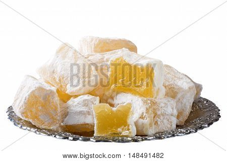 Sweet Turkish delight lokum traditional dessert on turkish plate isolated on white with clipping path included