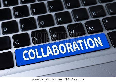 COLLABORATION a message on keyboard businessman working
