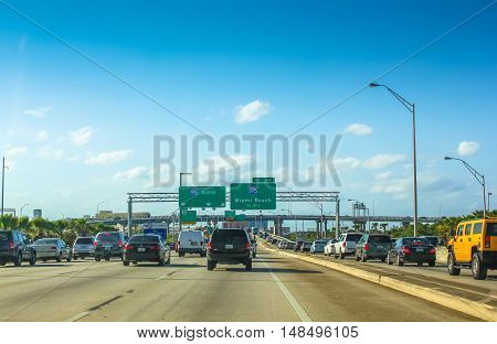 Miami, Florida, United States - April 8, 2012: cars driving on Miami Highway in the direction of Miami Beach. Interstate 95 is the main highway in the East Coast of the United States of America.