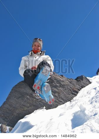 Woman On A Rock With Skiwears
