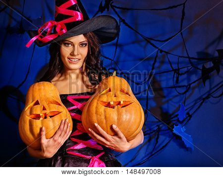 Happy halloween witch girl keeps orange pumpkin. Girl witch keeps halloween Jack OLanten.