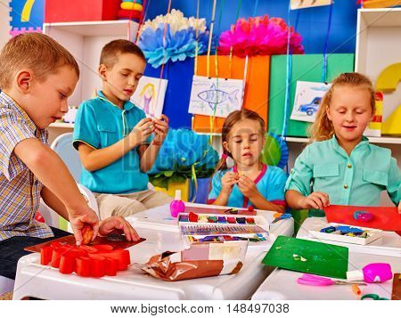 Group children boy and girl mold from plasticine in primary school. Plasticine lesson in primary school.