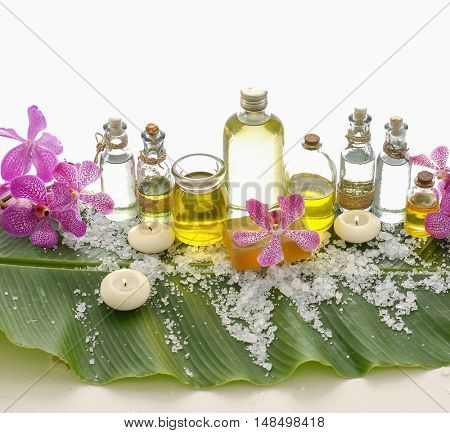 Spa setting on banana leaf with orchid, oil,candle